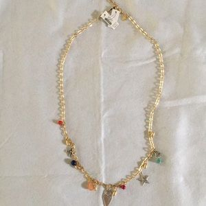 Gold necklace with charms